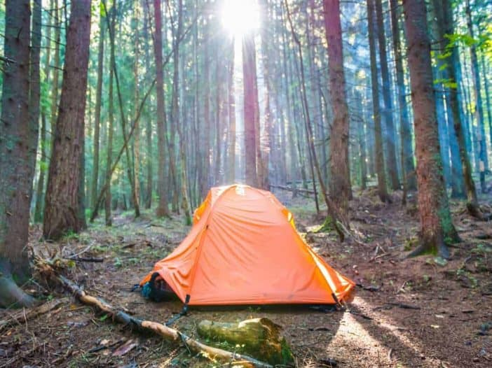 living in a tent to save money